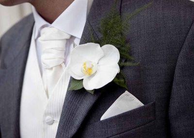 Gentleman's wedding button holds